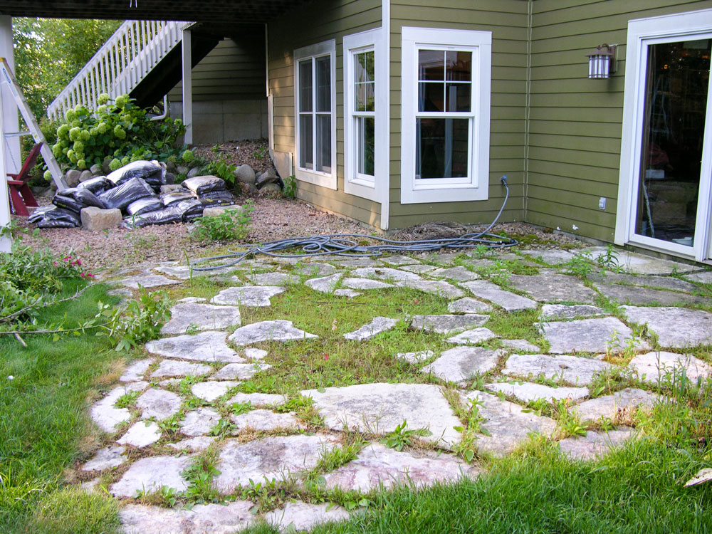 The patio that was causing drainage issues.